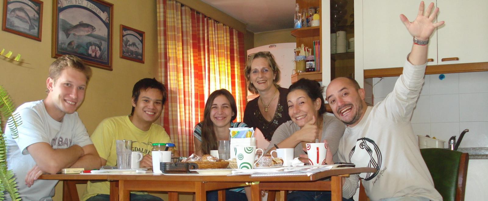 Spanish Language volunteers spending time together at their host family drinking some warm tea and coffee